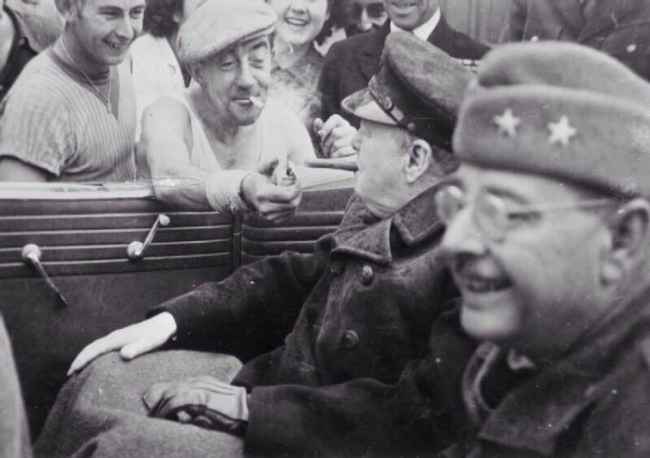 French man give light to Winston Churchill 1944